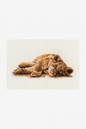 Reclining lion cub