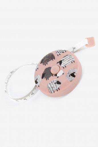 Cinta métrica en rosa